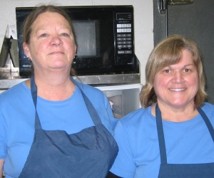 Lois Aultman (left) and Cathy Starkweather are the faces behind Club Mid and its catering operation. Photo by SUSAN HOOD
