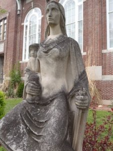 Pioneer Mother statue outside of Clare Middle School before cleaning. COURTESY PHOTO