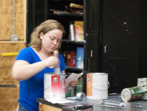"MMCC Stagecraft student Haleigh Rogers of McBain mixes the perfectpaint color for a flat for ""Leaving Iowa."" Photo by JANET SOWLE"