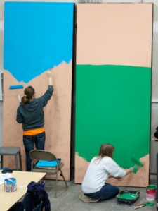 "Stagecraft students Amanda Brandenburg and Danielle Keysor paint a flat for ""Leaving Iowa."" Photo by JANET SOWLE"