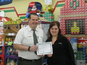Jenna Marshall receiving the award certificate from Todd Witbeck. COURTESY PHOTO