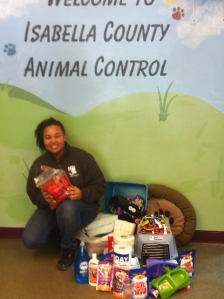 E:  A worker at the Isabella County animal shelter accepts  MMCC's donations