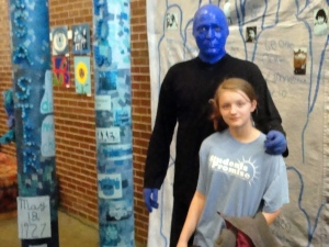 Pictured: Gladwin 7th grader Shyanne Nichols meets one of the members of the Blue Man Group