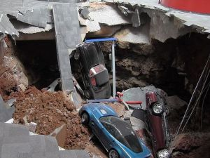 This photo by the National Corvette Museum shows the devastation from its unexpected sinkhole