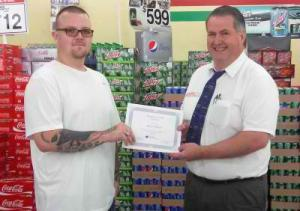 Student Walt Wilson accepts scholarship from Todd Witbeck