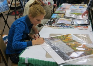 Artist Katrina Case-Soper signs prints
