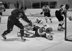 Lakers hockey team faces off against Aquinas in December 2011.