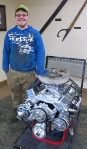 """Tyler LaPorte of Harrison is proud of his """"made from scratch"""" engine that will go in a '78 Firebird."""