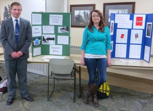Students Josiah Bear of Clare and Apryl Hudlow of Gladwin are poised to explain their poster projects.