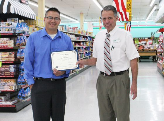 Jason Stevens (left) receives award from Witbeck's store director, Ken Ames