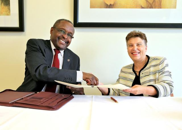 CMU President, George E. Ross (left), and MMCC President, Chris Hammond (right), after finalizing the new agreement